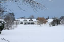 Picture postcard view of the clubhouse from 18th tee